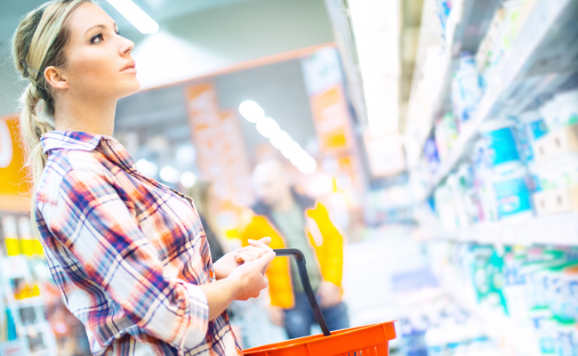 Woman shopping for toothpaste at local store